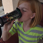 Maggie drinking from tumbler