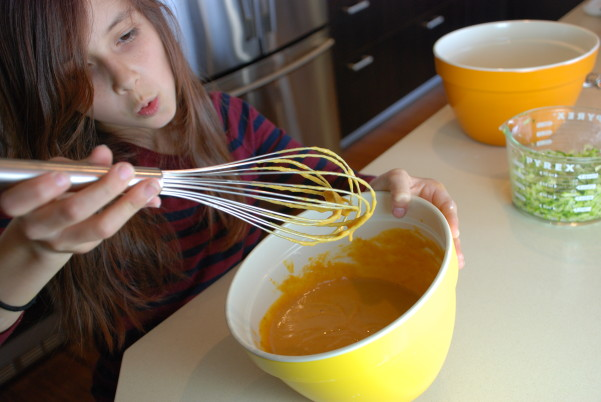 Mix the moist ingredients for best pumpkin zucchini muffins