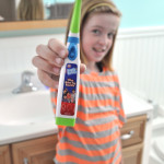 Tween with One Direction Tooth Tunes toothbrush