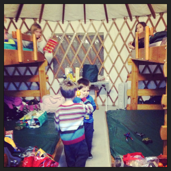 kids camping in yurt