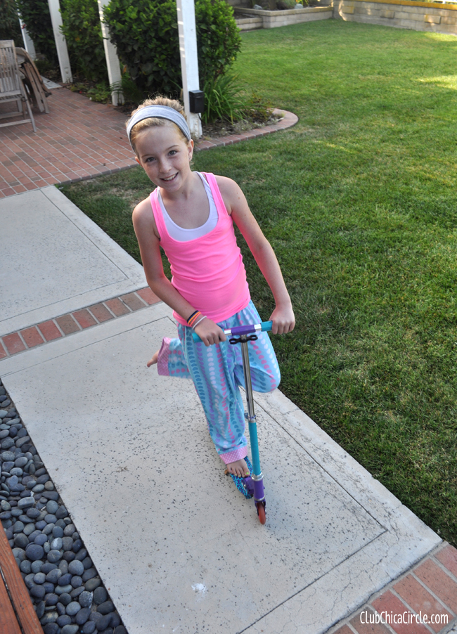 Tween on upcycled duct tape decorated scooter