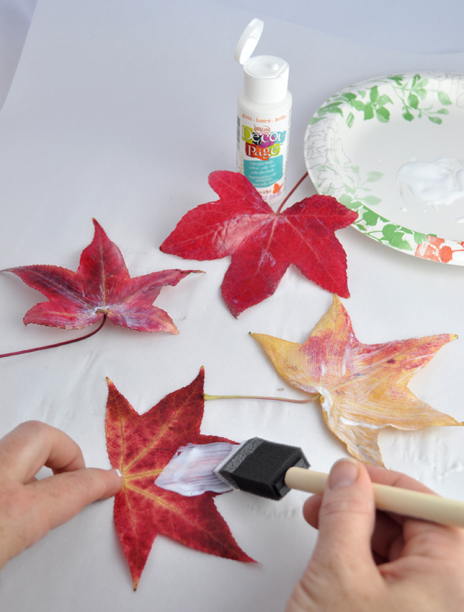 How to decoupage leaves onto a pumpkin
