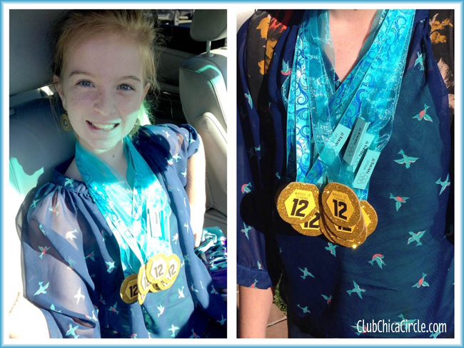 Tween wearing olympic homemade gold medal birthday invites