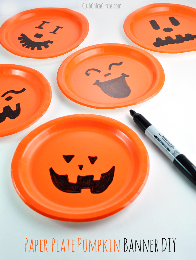 First step u2013 decorate your paper plate pumpkins by drawing on face designs on the front with Sharpie markers. & Paper Plate Pumpkin Easy Party Banner DIY | Club Chica Circle ...