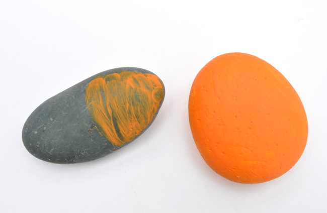 orange painted rocks for pumpkin Halloween home decor
