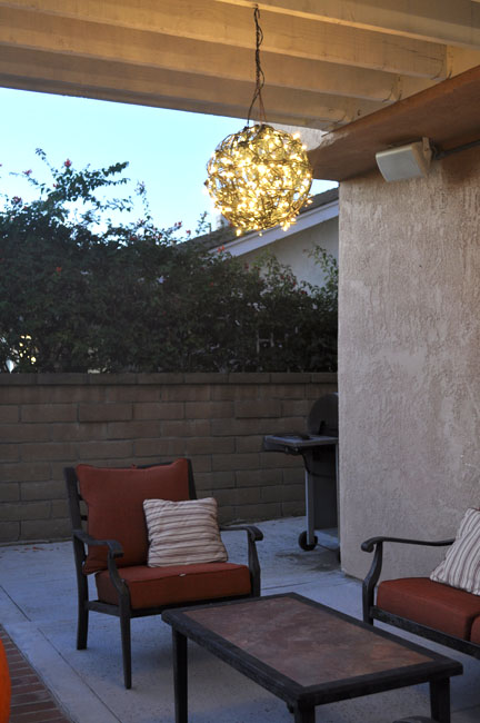 outdoor homemade chandelier - Repurpose Flower Baskets Into A Glowing Outdoor Chandelier