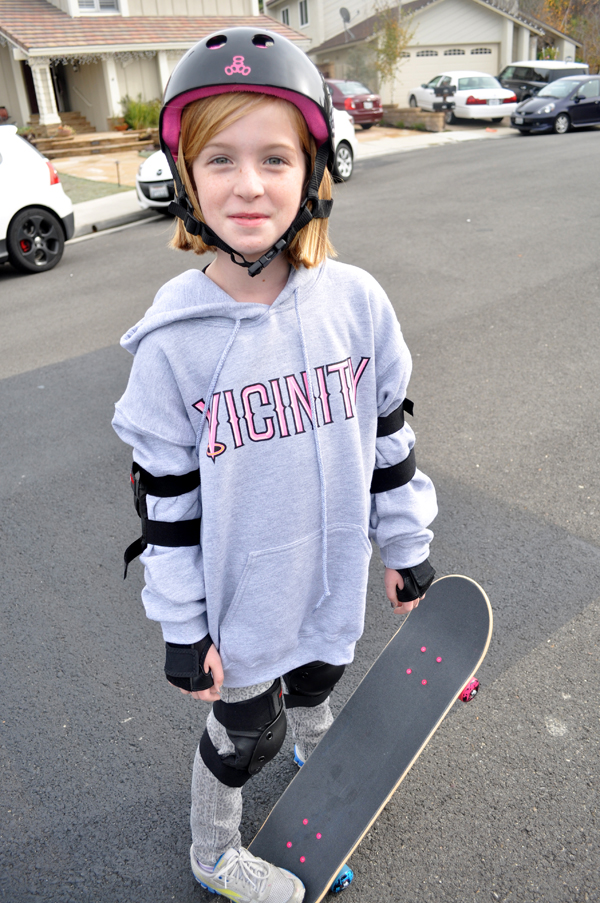 tween with skateboard