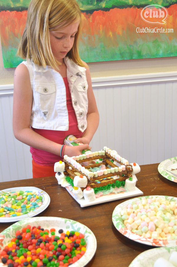 Tween girl making Peeps Candy House