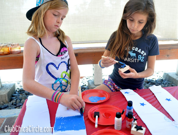 tweens crafting with homemade stamps and fabric paint