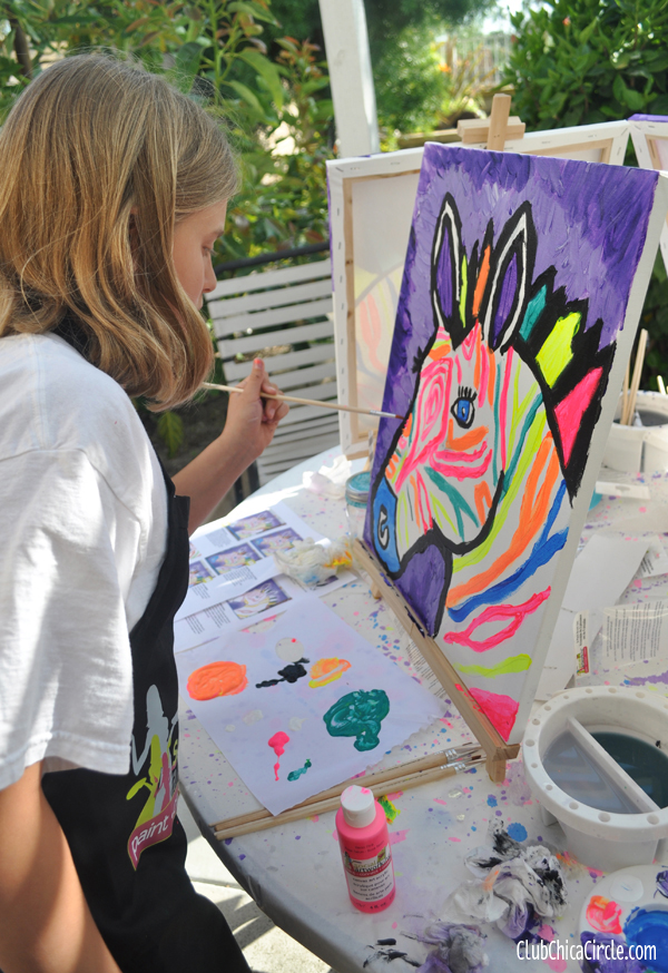 tween girl painting electric zebra at art party