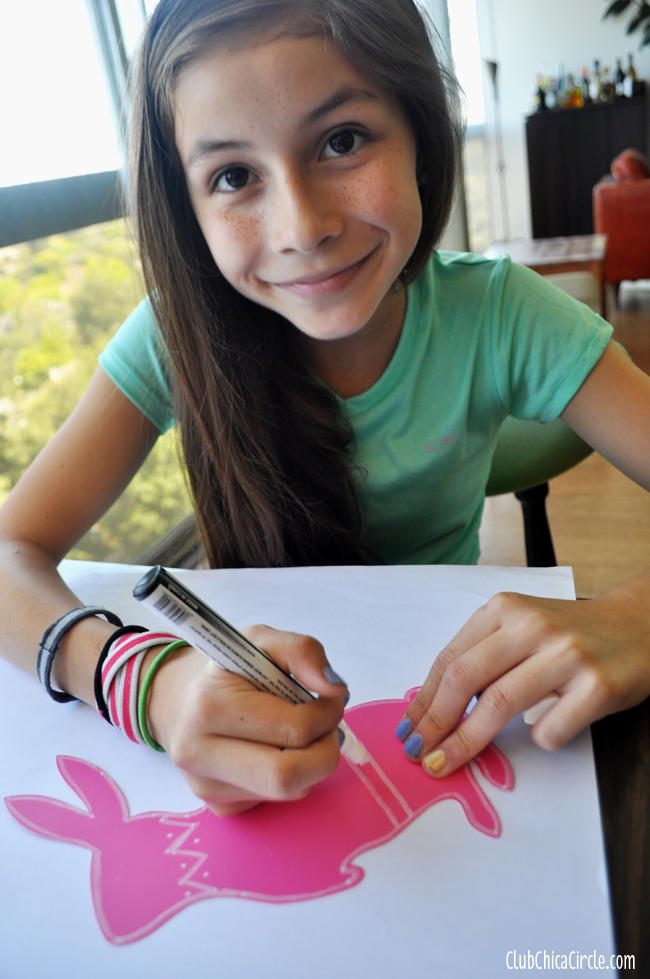tween decorating a chalkboard paper bunny window decoration