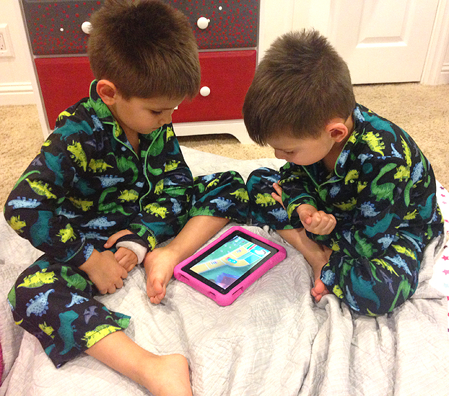 Twins loving the LIFE game on the Amazon Fire HD Kids Edition