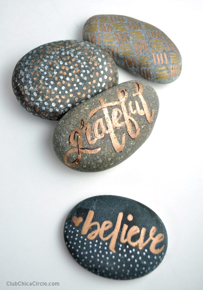 hand-lettered painted rocks with metallic sharpie markers